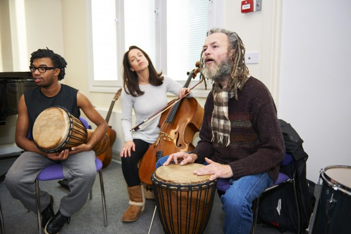 Nordoff Robbins Music Therapist and beneficiaries with drum