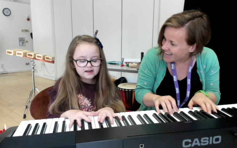 Nordoff Robbins music therapist and girl playing piano in Scotland