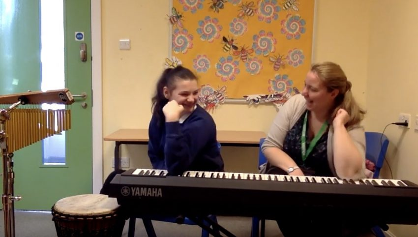 Nordoff Robbins Music Therapist and beneficiary with piano