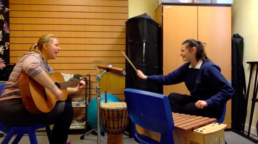 Nordoff Robbins Music Therapist and beneficiary with drum