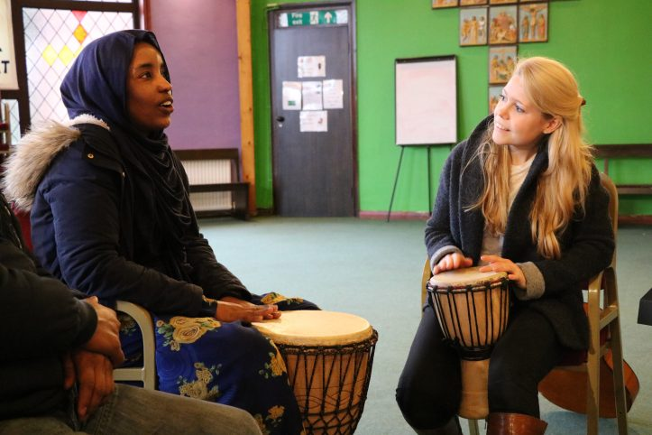 Nordoff Robbins music therapist and refugee playing drums in Manchester