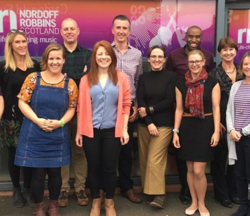 Members of the Nordoff Robbins team stand outside Nordoff Robbins Glasgow Centre
