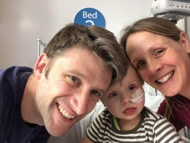 Young boy in hospital with parents