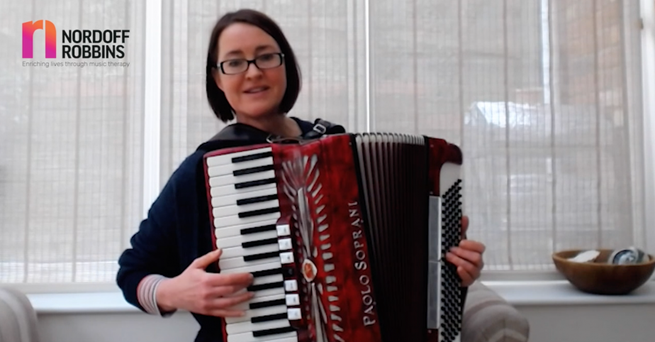 Gill, music therapist, playing an accordion