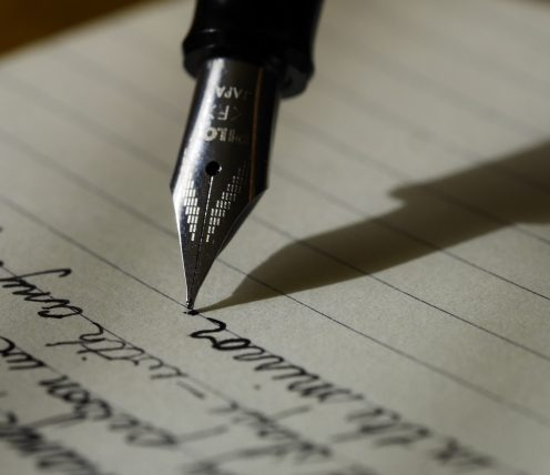 A fountain pen writing on a piece of paper