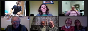 Screenshot of a Zoom call with John Wallis and therapy group members singing